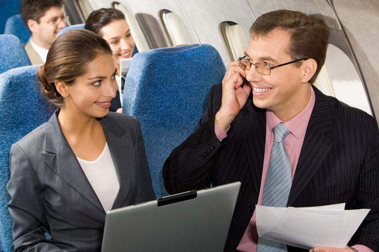 online travel consultant - laptop in aircraft cabin