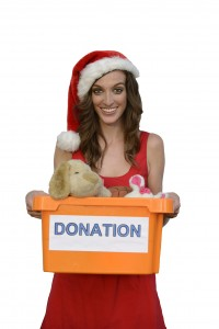 santa woman holding christmas toy donation box